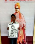 Dhanush-Kumar-with-his-Artwork