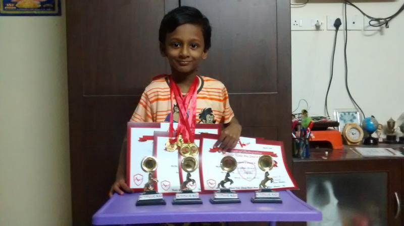 Posing with prizes he won in a recent competition